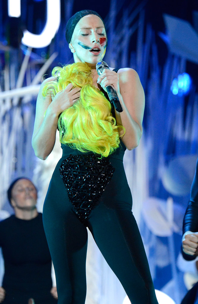 "Gaga tried on multiple hairstyles during her VMAs ""Applause"" performance. This fluorescent yellow bob was a crowd favorite."