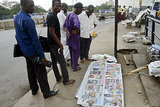 People in Nigeria gathered in Lagos, surveying a series of newspapers that covered Nelson Mandela's death.