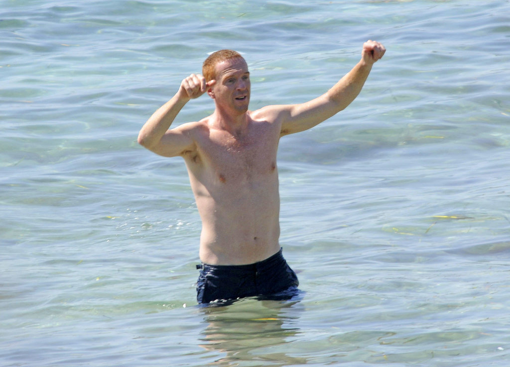 Homeland's Damian Lewis got animated in the water during an August trip to Ibiza.
