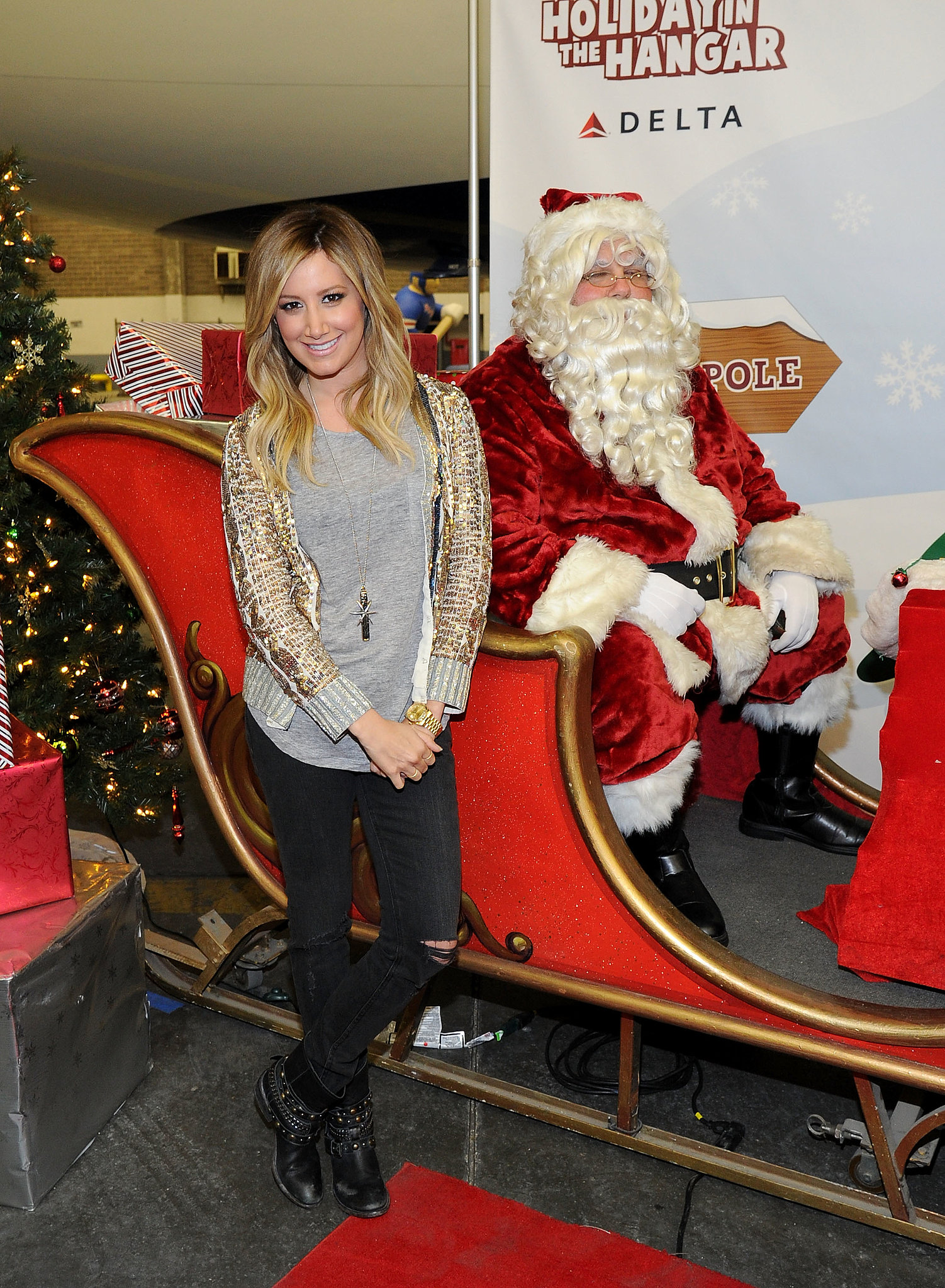"Ashley Tisdale jingled all the way with Santa Claus at the Delta ""Holiday Flight"" in NYC."
