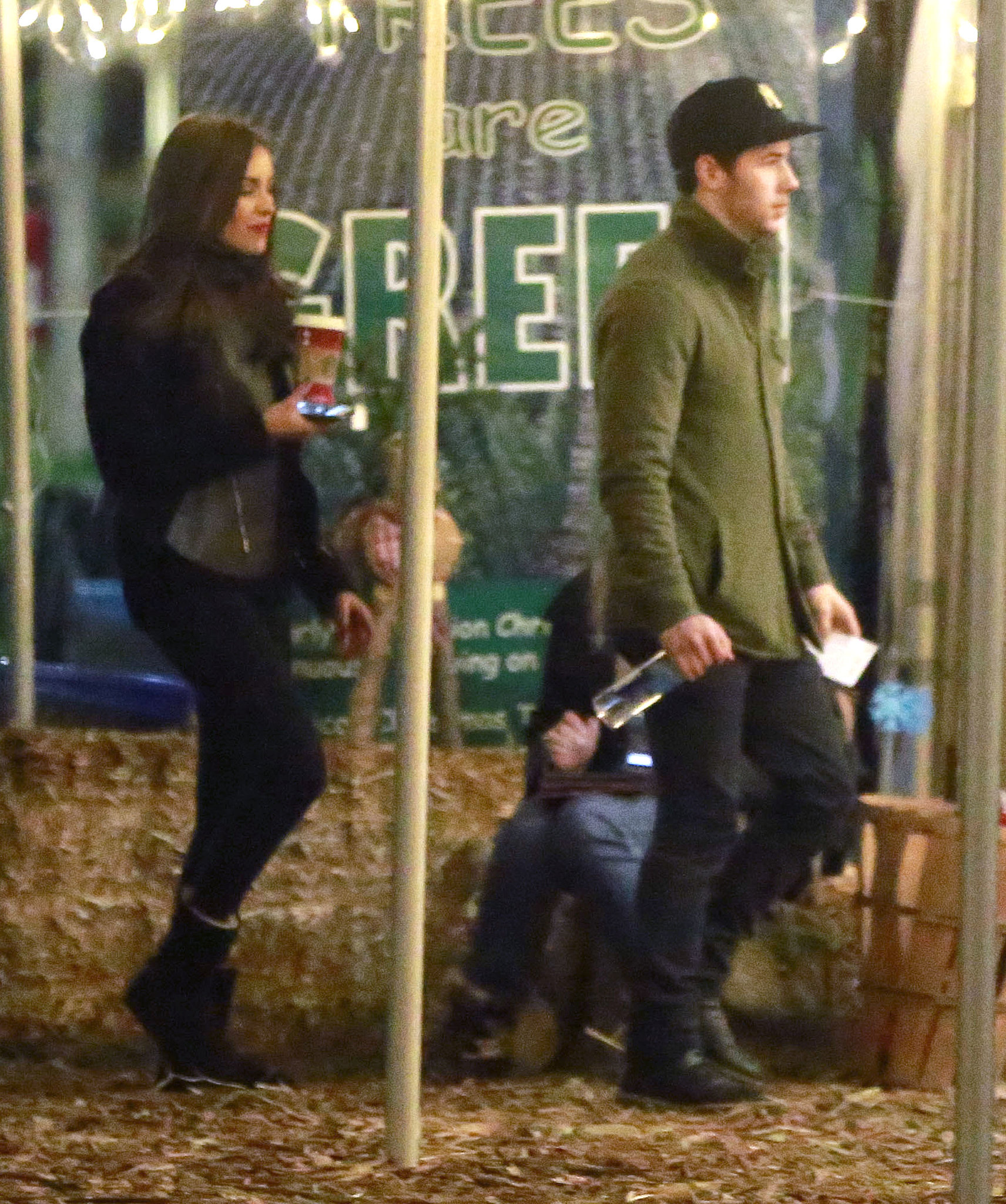 Nick Jonas and girlfriend Olivia Culpo wore matching boots while Christmas tree shopping.