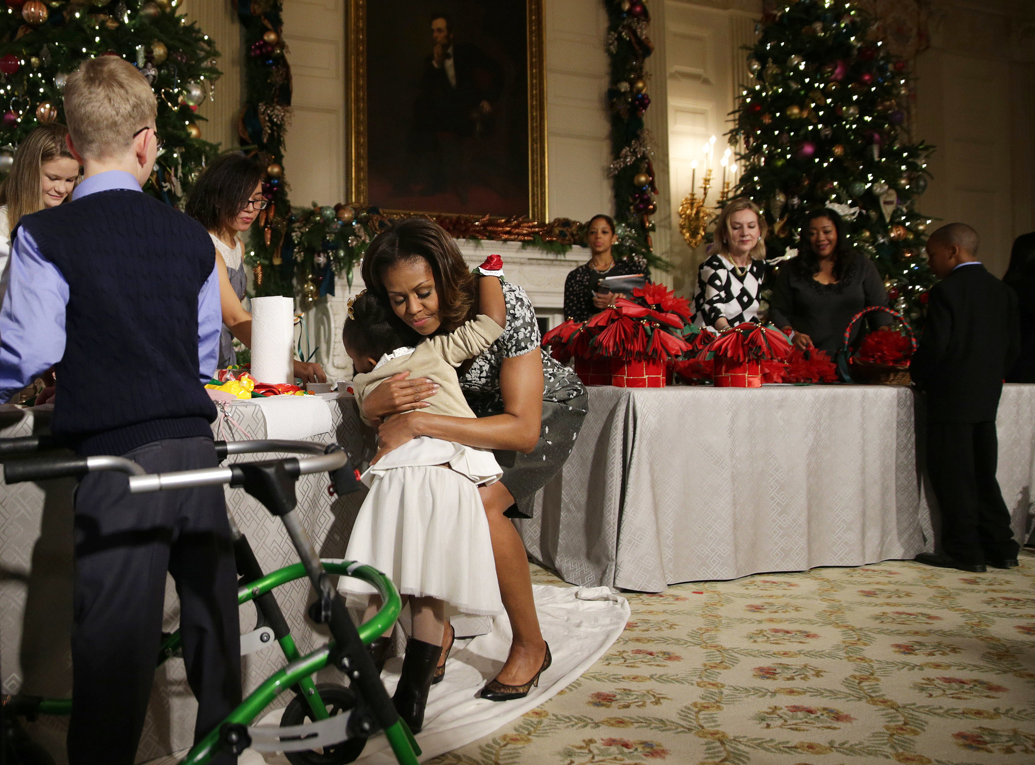 Michelle Obama leaned down for an embrace while introducing the 2013 White House holiday decorations.