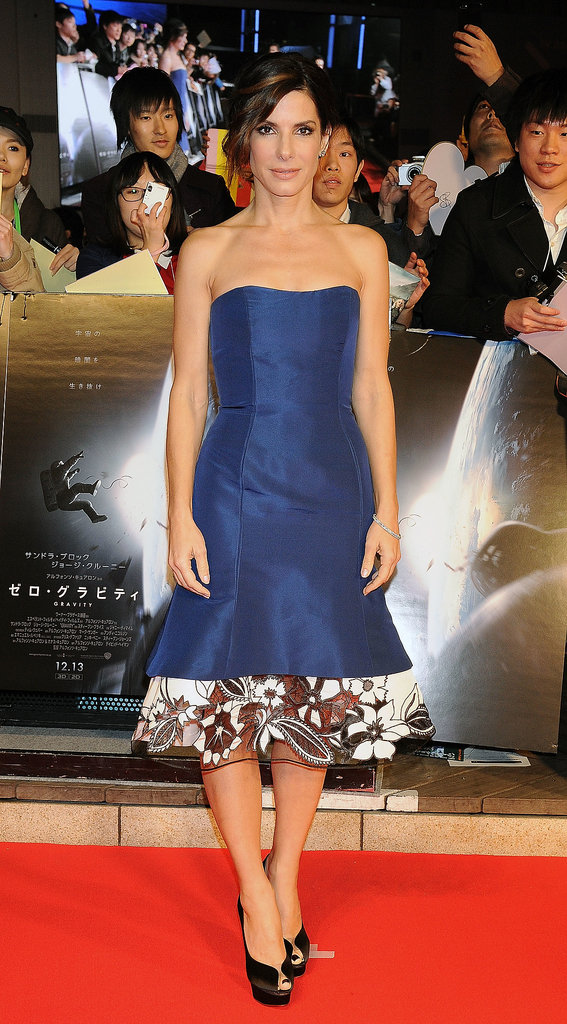 On the same page (with a feminine twist): Sandra Bullock's Carolina Herrera cocktail dress at the Tokyo Gravity premiere.