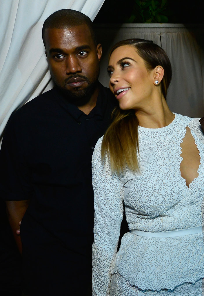 Kim Kardashian and Kanye West shared a moment at DuJour magazine's event to honor artist Marc Quinn at Delano South Beach Club on Wednesday.