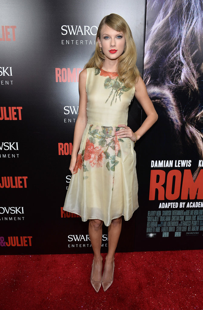Looking sweet and chic in an off-white tea-length dress by Reem Acra, blush satin pumps, and brushed curls for the Romeo & Juliet Hollywood premiere.