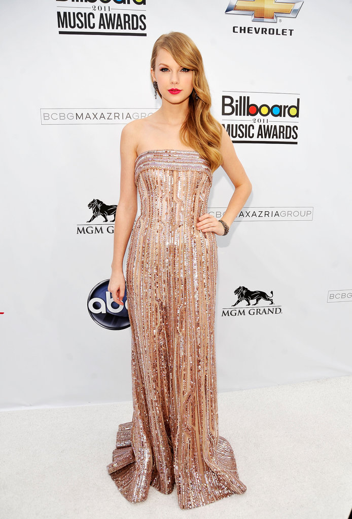 The epitome of retro Hollywood glamour in a sparkling Elie Saab gown, soft waves, and a bright red pout at the 2011 Billboard Music Awards.
