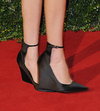 The silhouette of Alexa Chung's black ankle-strap shoes was too chic to ignore.