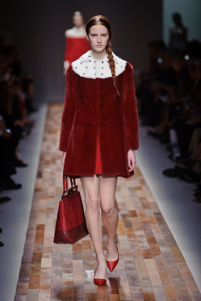 Then there was this Valentino look. This fur jacket with its rich red color and white ermine collar was the ultimate in Santa-approved style. And what could be more primed for hauling around gifts than that gigantic bag?