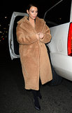It doesn't get much cozier than Kim's teddy bear Max Mara topper!