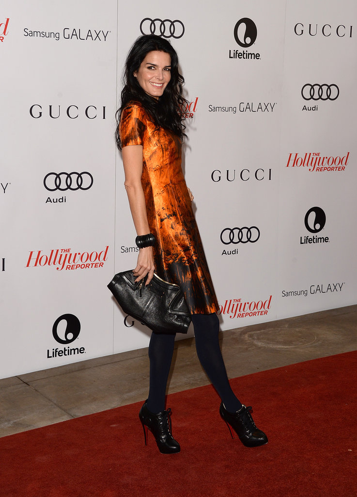 Angie Harmon graced the red carpet in a bright orange dress.