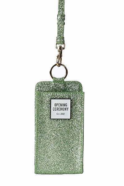 We can think of a few friends who'd trade their hefty shoulder bags for a cool case like this Opening Ceremony Glitter Phone Case ($45).
