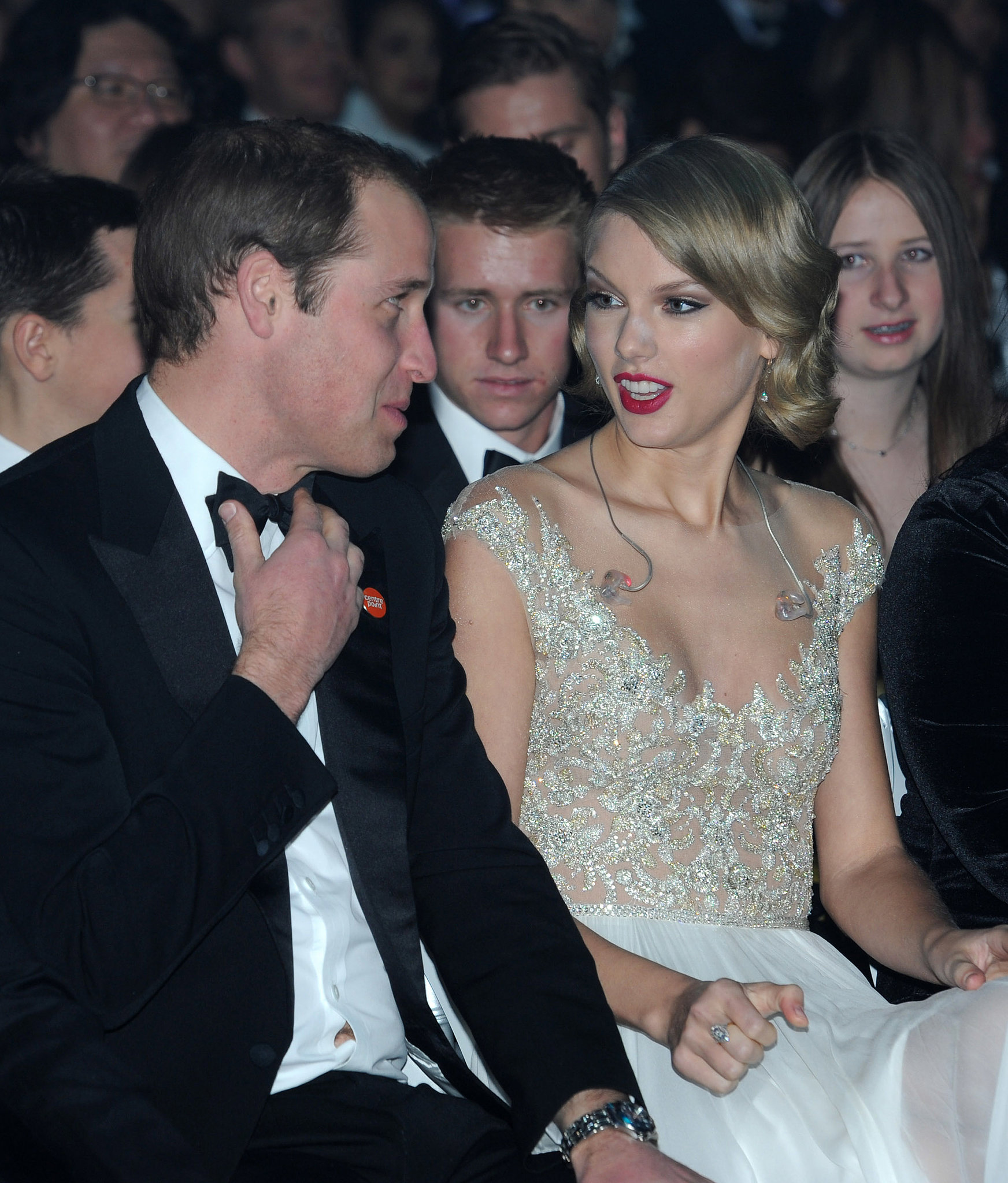 Taylor Swift had a shocked facial expression while attending the Winter Whites Gala with Prince William in November 2013.