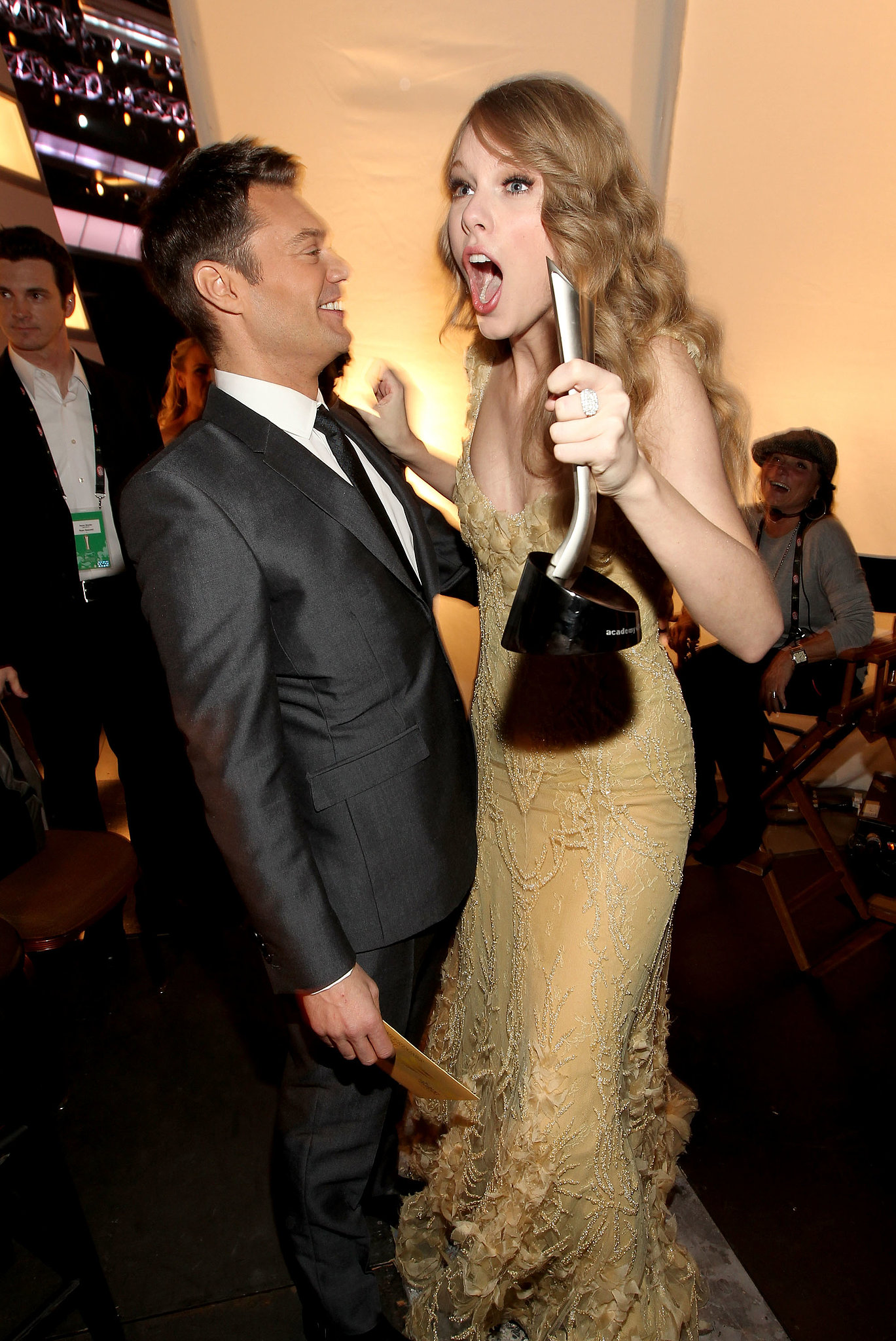 Taylor Swift celebrated her award win with Ryan Seacrest at the ACMs in April 2011.