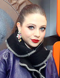 Michelle Trachtenberg's slicked-back ponytail is the perfect style for showing off statement party earrings, winged eyeliner, and a bold pout.