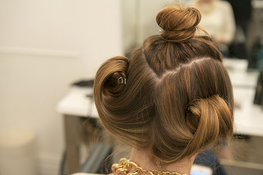 Repeat blow-drying the other section the same way, and secure into a pin curl. Before you start on the top section, your hair should look like this. Source: Caroline Voagen Nelson