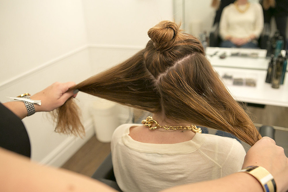 Once your hair is mostly dry, section the top of your hair in a V-shape, and then separate the bottom section in half, as shown. You don't have to worry about the parts being perfect. Source: Caroline Voagen Nelson