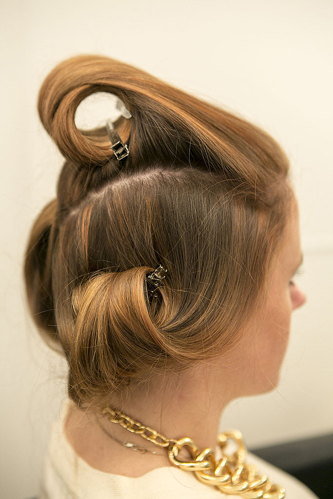 Twist the top section away from your face, and set the curl with a pin. Let your hair set while it cools — this is the perfect time to do your makeup! Halpin sprayed the pin curls with a flexible-hold hair spray, Oribe Superfine Hair Spray ($36). Source: Caroline Voagen Nelson
