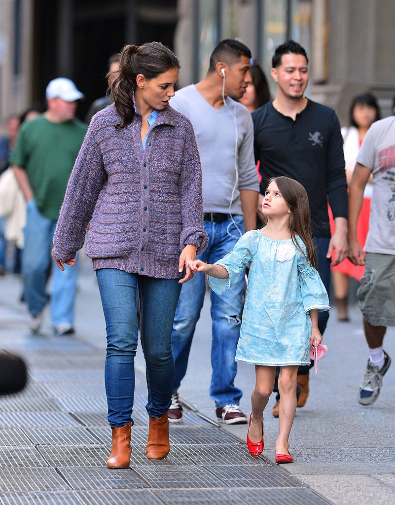Katie cozied up in a marled button-down sweater while walking hand-in-hand with daughter Suri in September 2012.