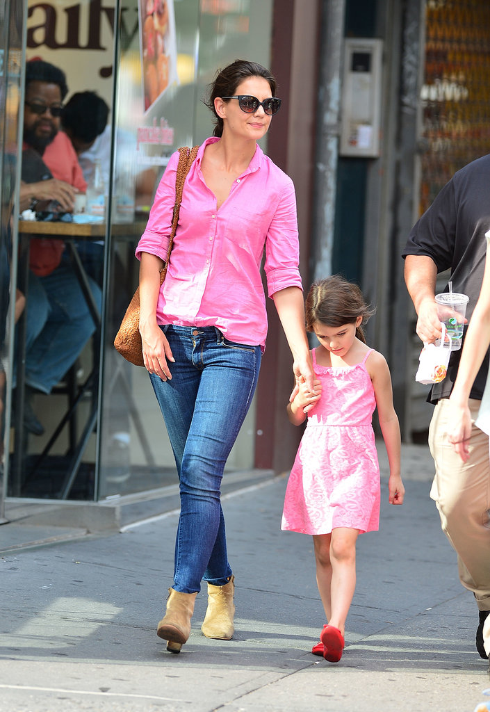 Katie and Suri coordinated in bright pink ensembles while cruising the streets of Manhattan in July 2012.