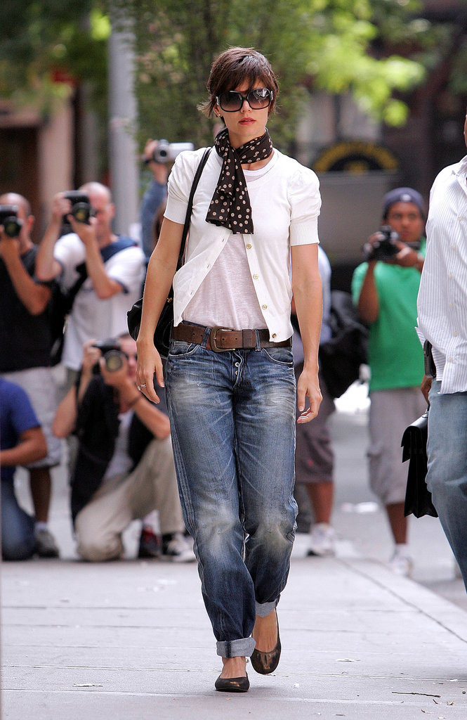 Katie juxtaposed her sweet cardigan and polka-dot scarf with slouchy boyfriend jeans and a rugged leather belt in 2008.