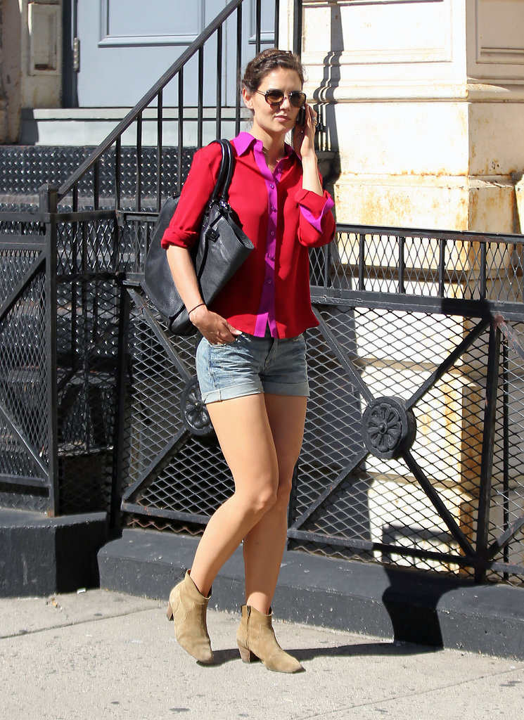 For a September 2011 stroll, Holmes brightened her cuffed denim shorts with a fuchsia and red colorblock blouse.