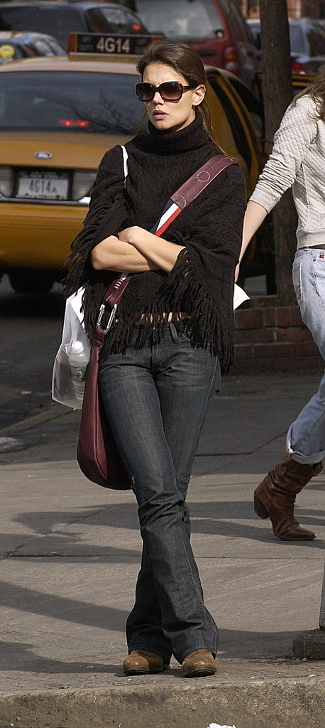 A fringed black poncho kept Katie toasty in NYC in Spring 2005.