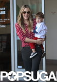 Molly Sims was all smiles while holding her son, Brooks Stuber, in LA.