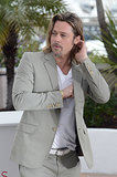 Brad Pitt tucked his hair behind his ear while at a Killing Them Softly photocall during the Cannes Film Festival in May 2012.