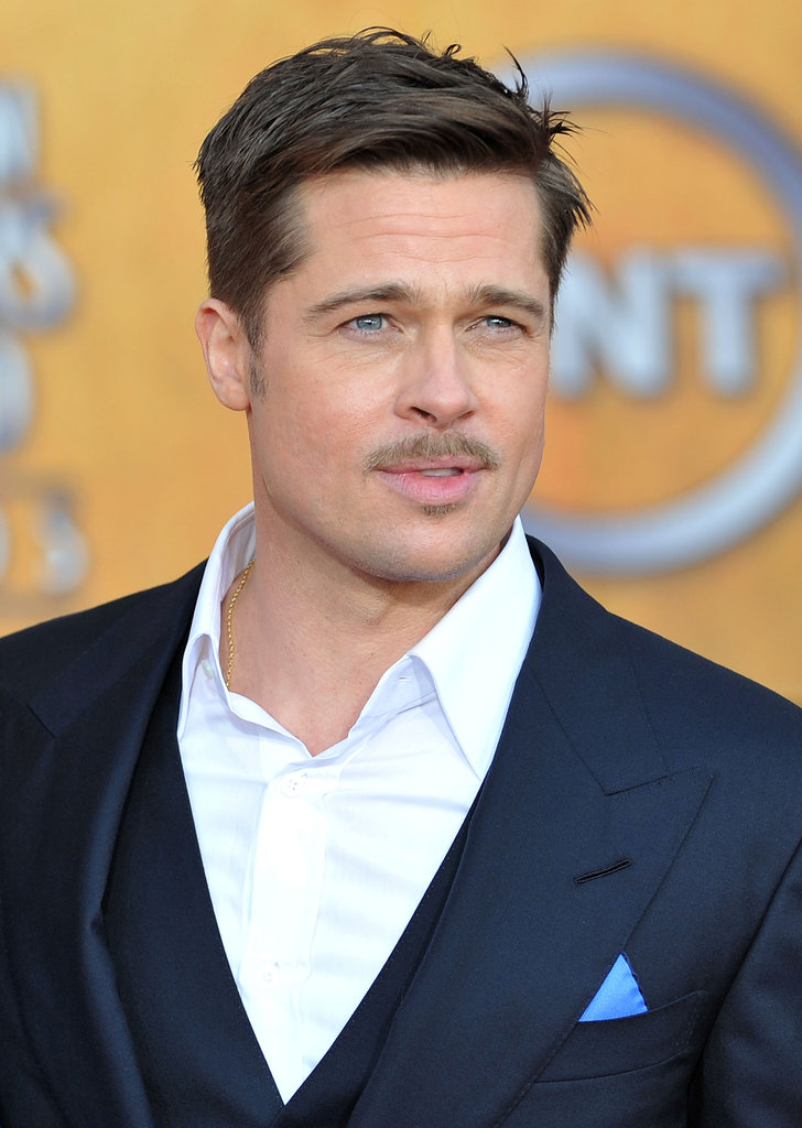 It wasn't exactly Movember — it was January 2009 to be exact — but Brad Pitt nailed the manicured mustache look at the SAG Awards in LA.