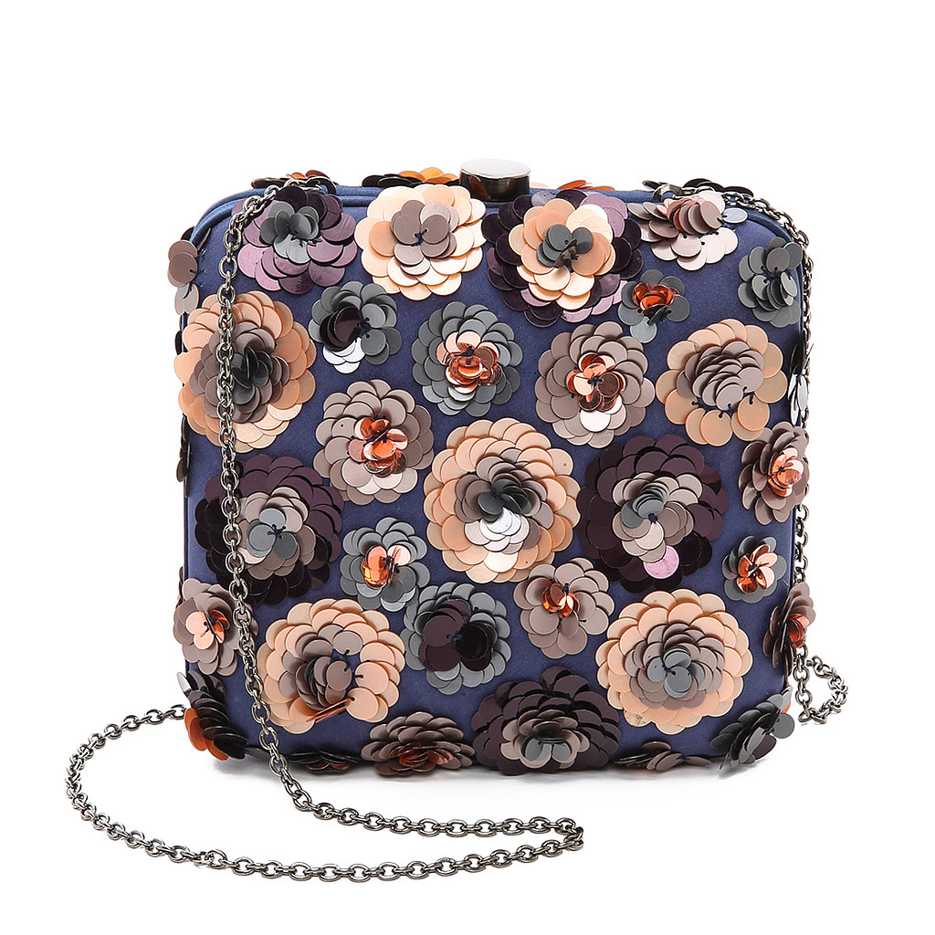 The floral design on this Santi clutch ($240) will definitely help your style blossom.