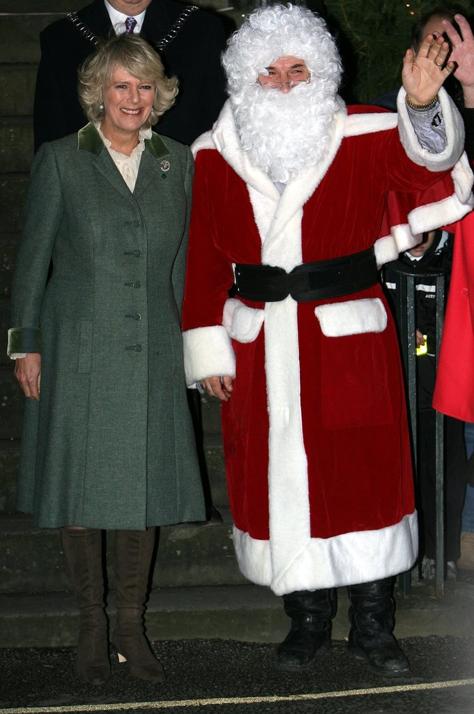 Camilla, Duchess of Cornwall, linked up with Santa Claus at a tree-lighting ceremony in 2006 in Tetbury, England.