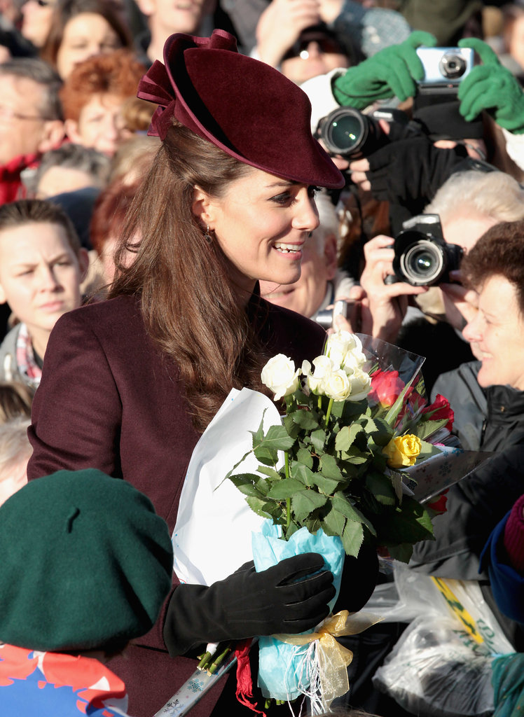 The crowd snapped pictures of Kate Middleton on Christmas Day 2011.