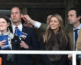 The future king of England got his ear pulled by a friend while at the horse races.