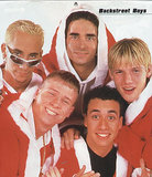 The Backstreet Boys Paired Santa Suits With Silver Shades and Chain Necklaces