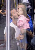 In May, David Beckham planted a sweet kiss on Harper at an LA Kings game.