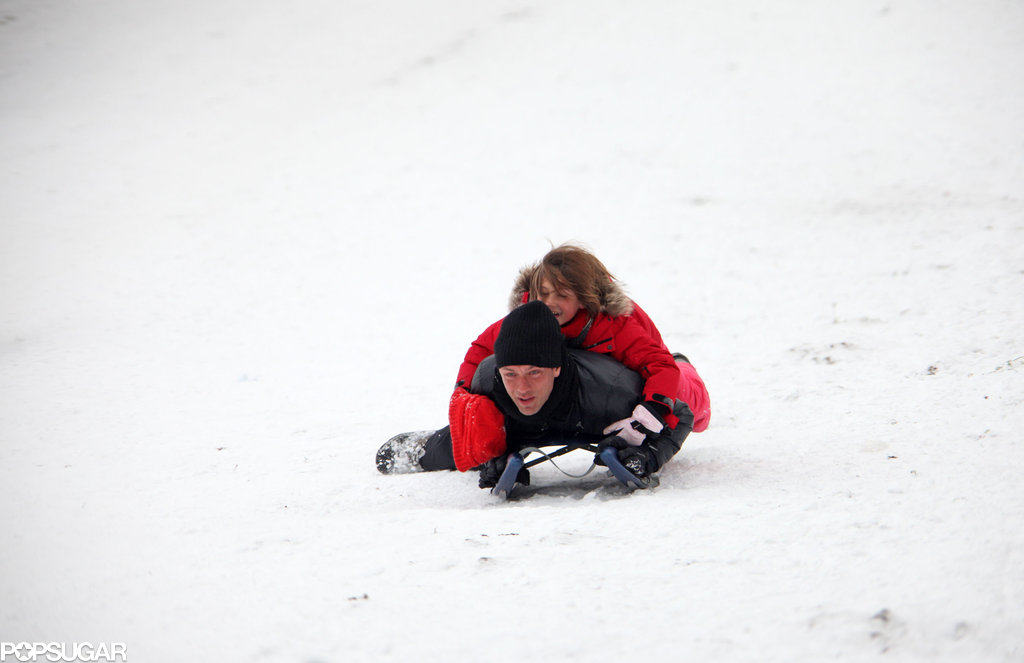 Jude Law manned the sled with his daughter Iris in London in 2010.