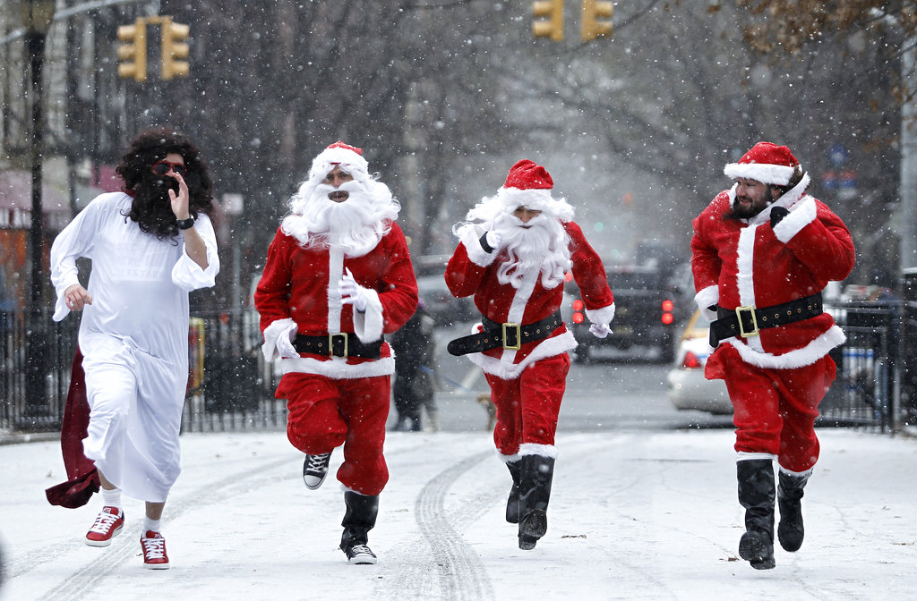 In NYC, guys dressed in festive gear ran through Tompkins Square Park during the SantaCon bar crawl.