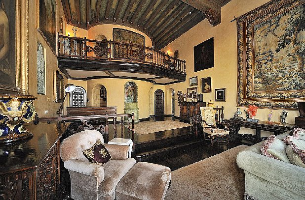 The large tapestry hanging from the wall only heightens the castle effect. Source: Teles Properties