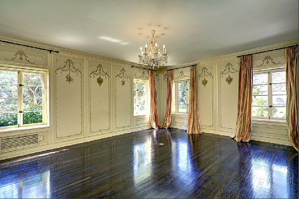 The paneled detailing reminds us of another royal home — Versailles!  Source: Teles Properties
