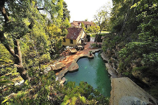 Another view of the pool and yard. Source: Teles Properties