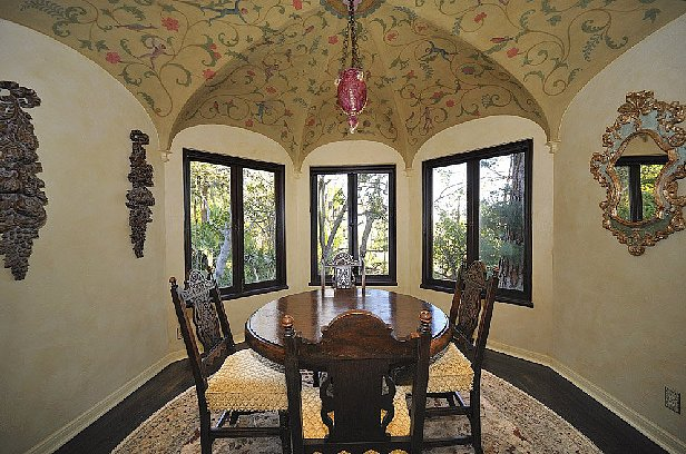 We would expect a more whimsical theme for this nook's painted ceiling. Clouds, perhaps?  Source: Teles Properties