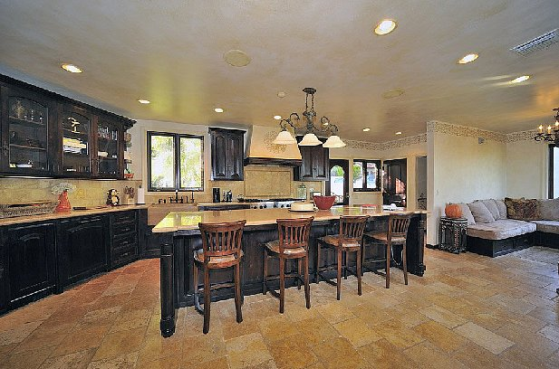 The expansive kitchen even has room for a lounging area. Source: Teles Properties