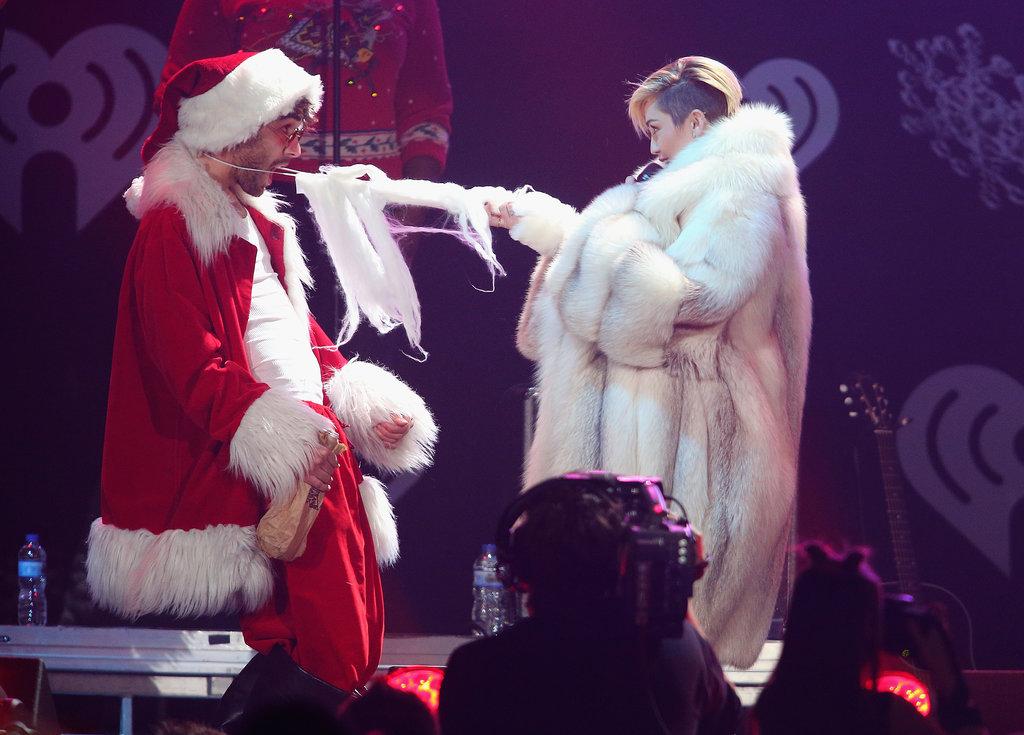 Miley Cyrus grabbed on to Santa's Beard.