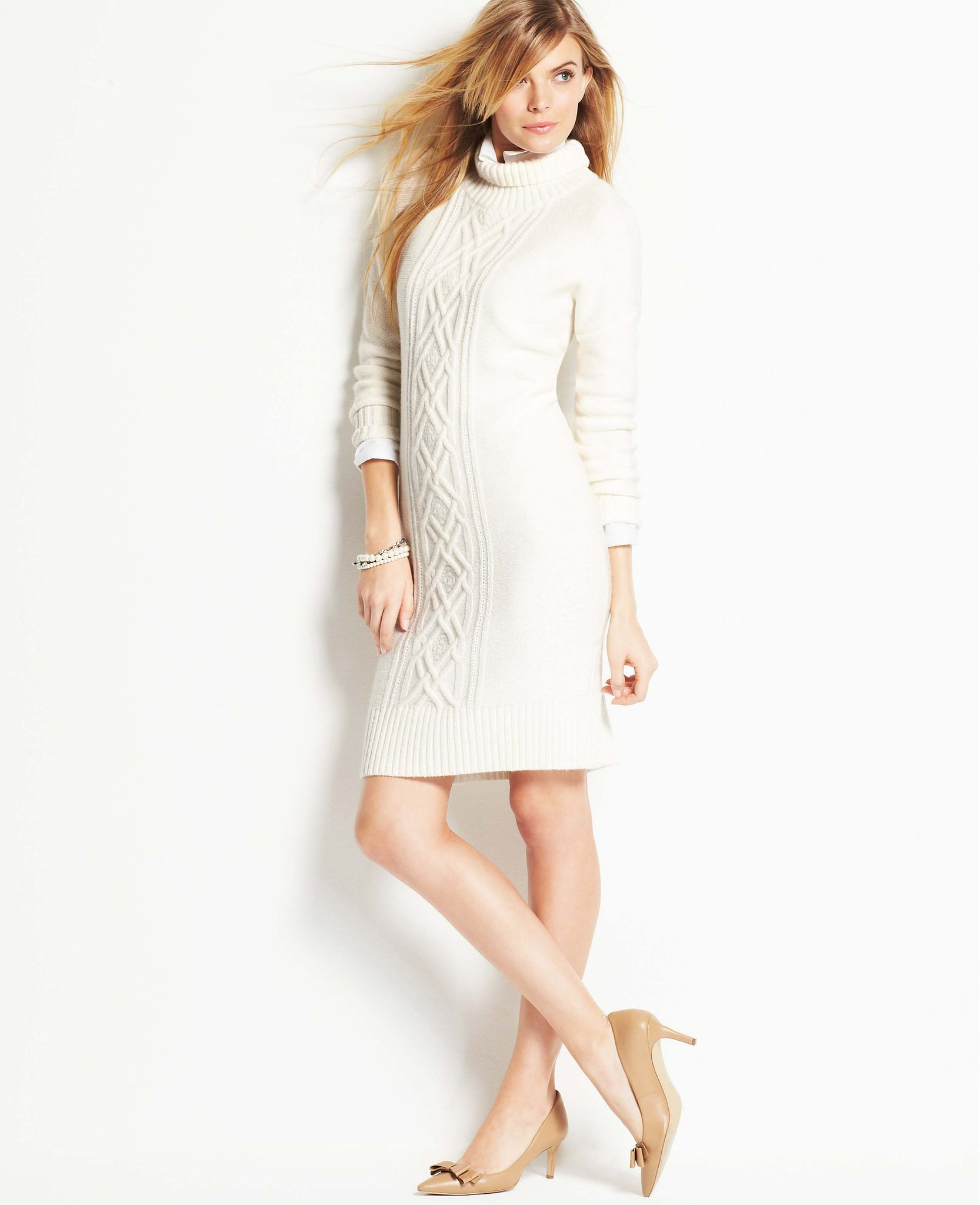 The next step for someone who loves an oversize, chunky sweater? A sweater dress with the same vibe. I'd wear this Ann Taylor style