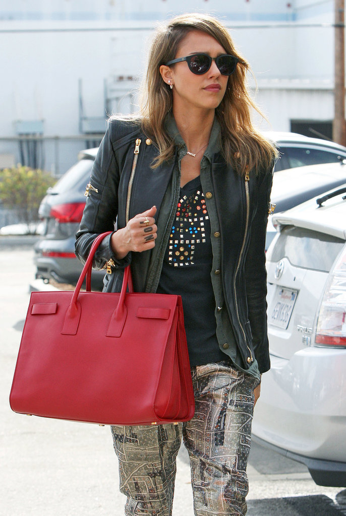 Jessica Alba went bold by picking a cherry-red style rather than the more commonly spotted neutrals.