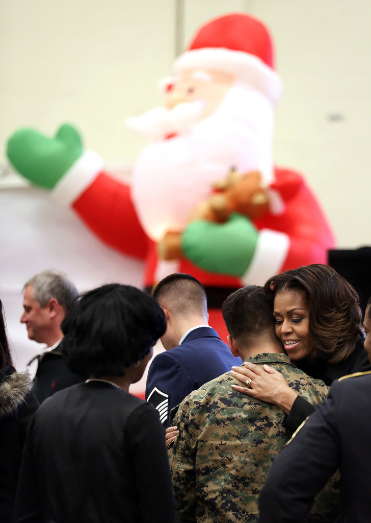 Michelle Obama hugged a Marine during the toy drive.