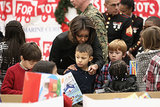 Michelle Obama helped children find gifts at the Military Corps Toys For Tots toy drive.