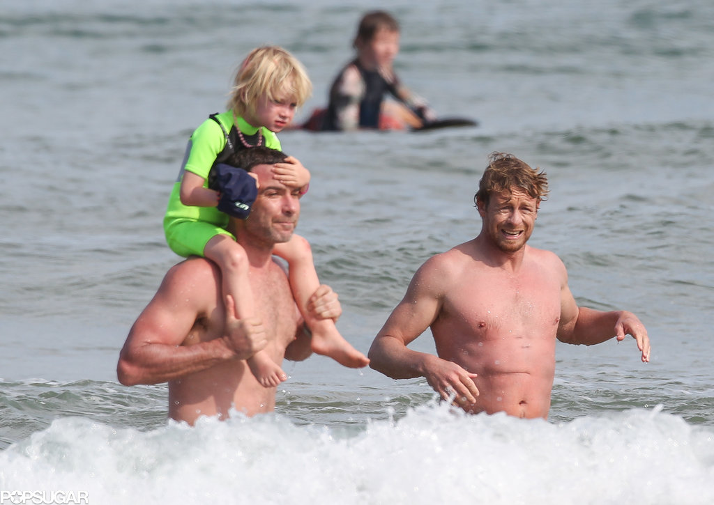 Liev Schrieber and Simon Baker took a dip in the ocean with Liev's son Samuel in Sydney on Friday.