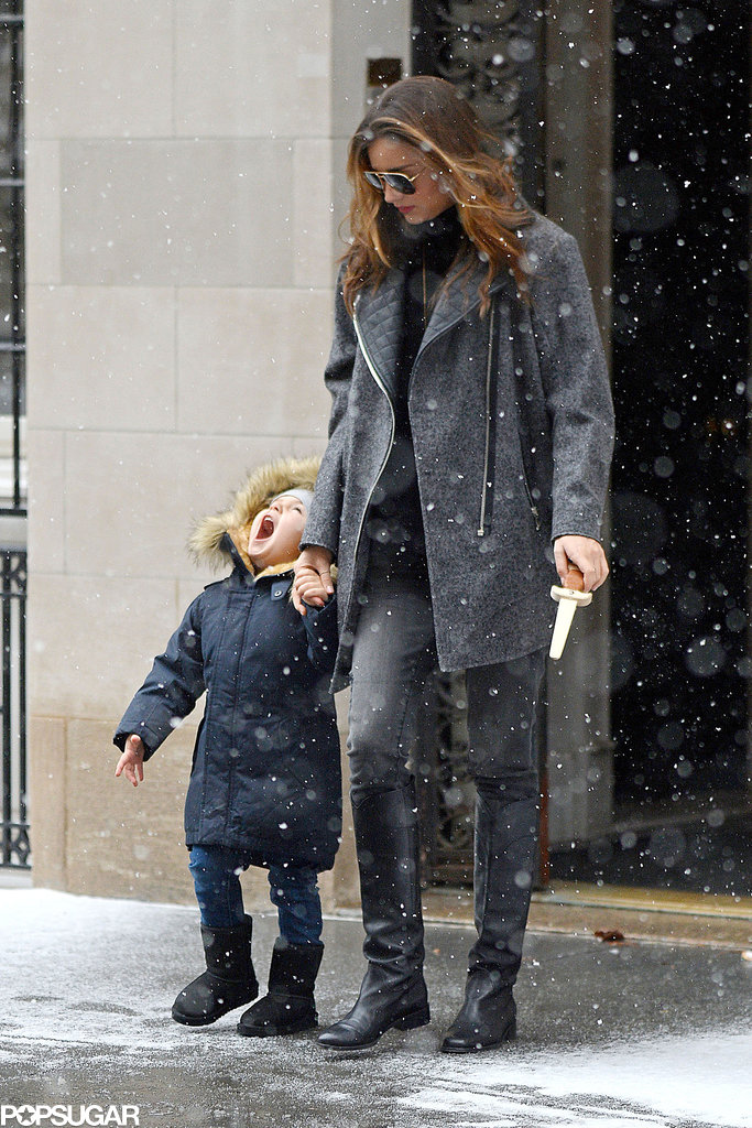 Miranda Kerr stepped out in NYC on Saturday with her adorable son, Flynn Bloom, who melted our hearts while trying to catch snowflakes on his tongue.