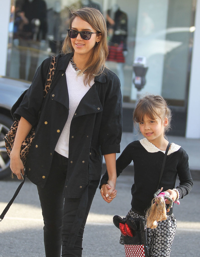 Jessica Alba held hands with her daughter Honor Warren as they crossed the street in LA on Sunday.